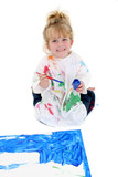 adorable young girl painting poster board on floor poster