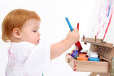 Fototapety adorable baby girl painting at easel