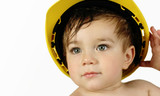 toddler boy in construction hat poster