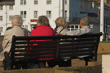 elderly ladies on a bench