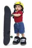 small boy with large helmet shoes and skateboard poster