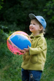 the cheerful kid with a ball poster