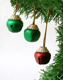 three bells hanging from branch of christmas tree poster