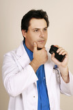 doctor recording patient information poster