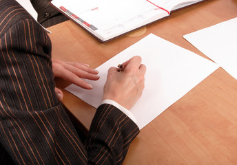 woman writting on blank paper