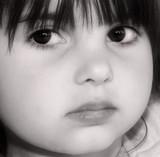 intense gaze of a child poster