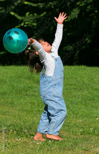 a child paying with a ball