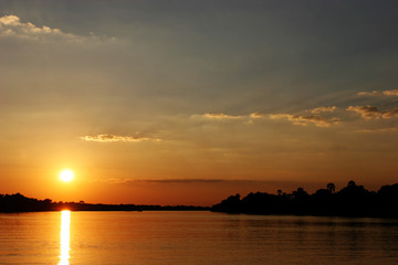 sunset in zimbabwe over zambezi river