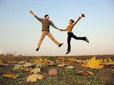 jump couple autumn leaves