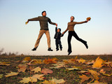fly happy family with autumn leaves
