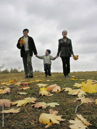 walking family with autumn leaves and clouds