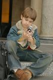 schoolboy sitting on steps poster