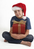 sitting boy with christmas gift poster