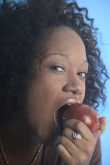 close up of a girl eating an apple