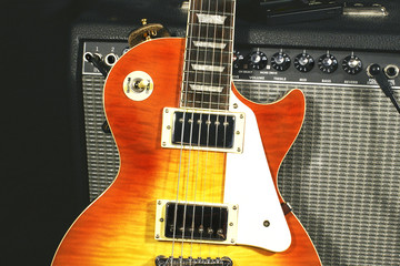 sunburst electric guitar and amplifier