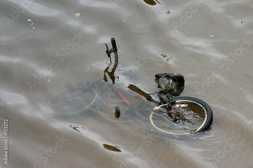 kids mountain bike in river