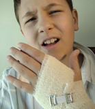 boy with injured bandaged hand