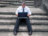 businessman with laptop outdoor poster