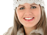 beautiful young woman in knit hat and fur trimmed poster