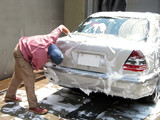 man cleaning the car poster