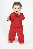 standing baby eating rusk poster
