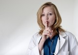 lady doctor saying quiet poster