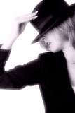 lady wearing black hat poster