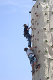 climbing a fake rock wall poster