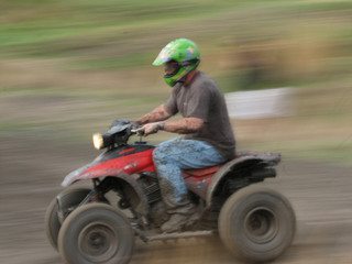 man on a quad bike racing