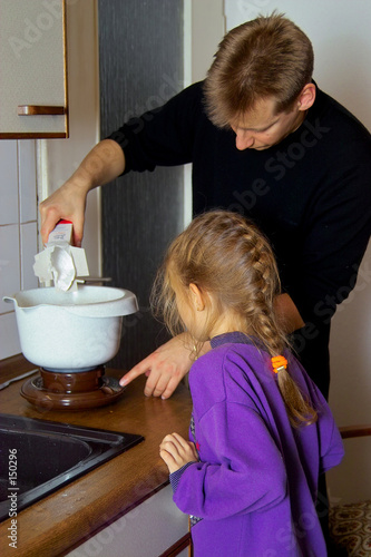 girl cooking with dad