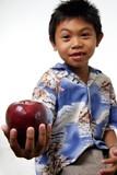 kid offering apple poster