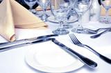 formal dinner setting in cool lighting poster