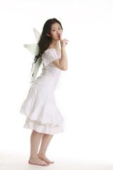 white fairy asking for quiet