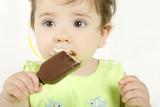 baby girl eating an ice cream mini poster