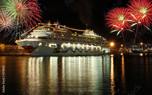 cruise boat at night with fireworks