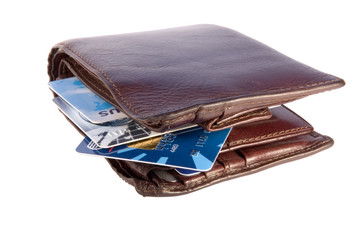 old wallet with credit cards inside, isolated on w