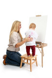 baby girl painting with help from mom poster