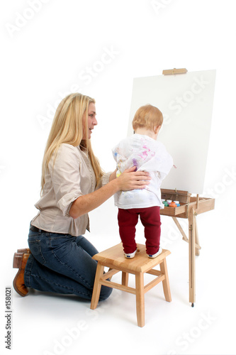 poster of baby girl painting with help from mom