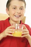 a child drinking orange juice poster