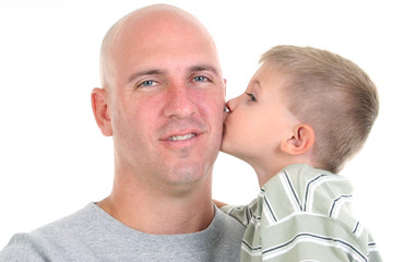 stock photography: son kissing dad on the cheek