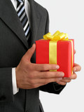 businessman holding gift poster