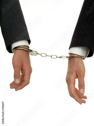 businessman's hands in handcuffs