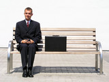 businessman sitting on bench poster