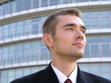 businessman outside a modern office building poster