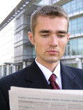 businessman reading newspaper poster