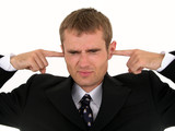 businessman putting fingers in ears poster