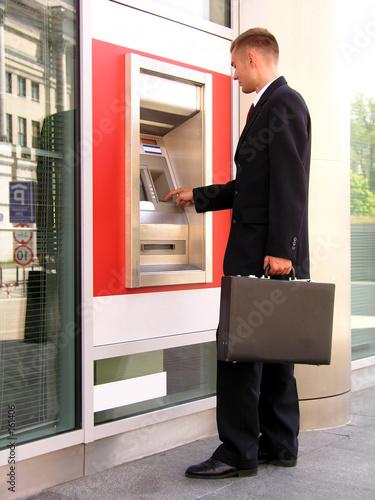 poster of businessman using cash machine