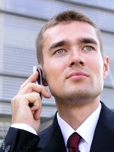 poster of businessman using a mobile phone