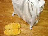 oil heater and plush slippers poster