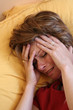 woman in bed with migraine